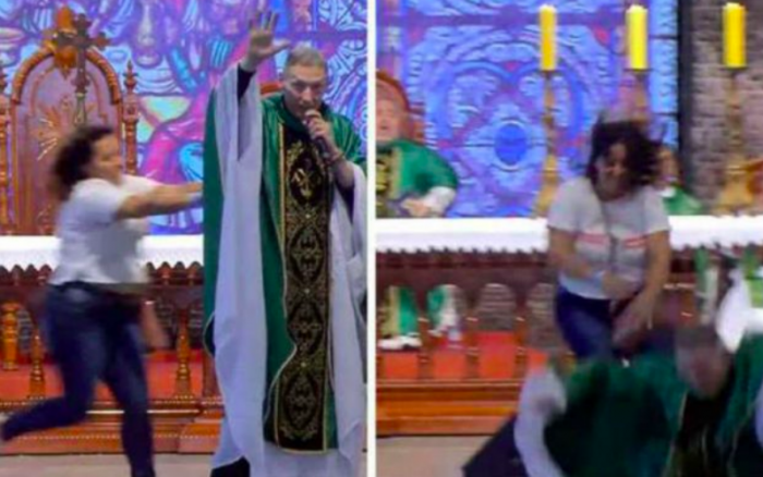 Lady pushes Catholic Priest Fr. Marcelo Rossi, down from the altar while he was preaching in Brazil (Video)