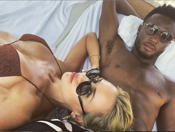 Loved-up photo of Mikel Obi and his partner, Olga Diyachenko lounging together