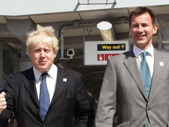 UK's foreign secretary, Jeremy Hunt walks out of Boris Johnson's cabinet after turning down defence post