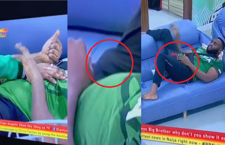 Ouch! BBNaija housemate Nelson stylishly covers his erection after his love interest Esther places her hand on him (Video)