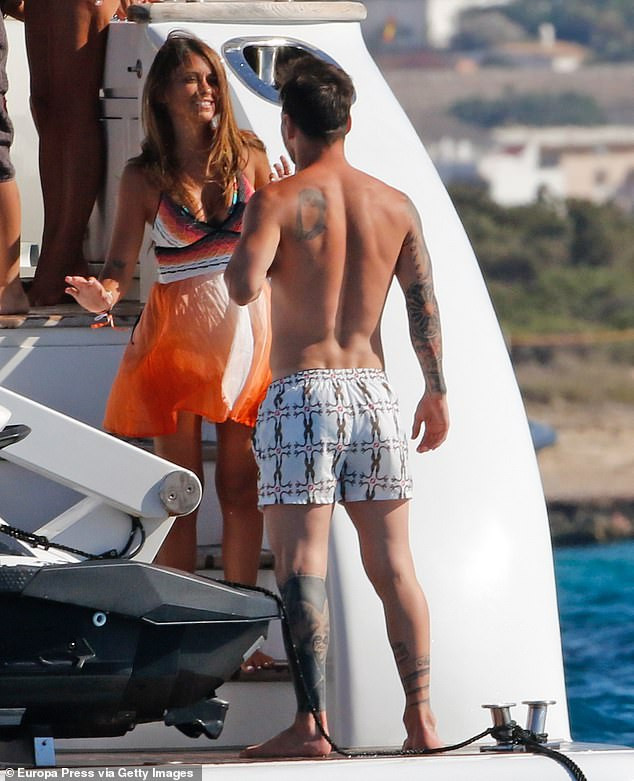 Lionel Messi and his stunning wife Antonella Roccuzzo pack on the PDA aboard a luxury yacht in Ibiza (Photos)