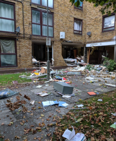 """Three people injured after flat """"explodes"""" in south London"""