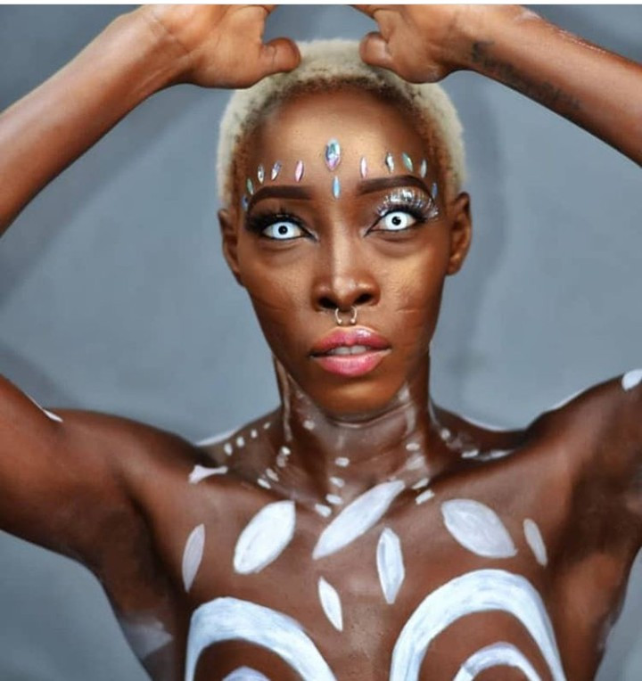 """I will not change for no one"" - Model Adetutu says as she poses naked with only body paint and nipple pasties covering her modesty (photos)"