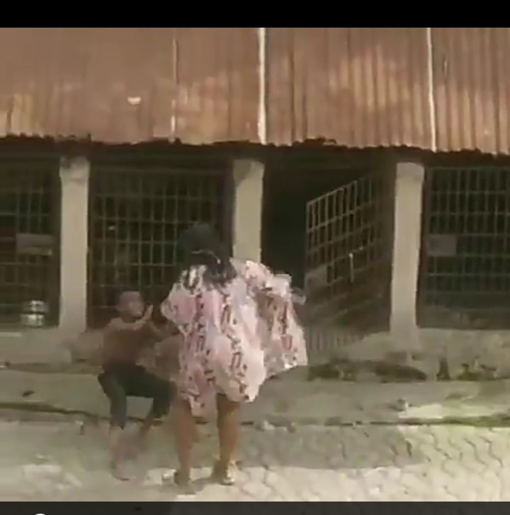 Outrage as Nigerian woman is filmed flogging a child and locking him up in cage with fierce dogs