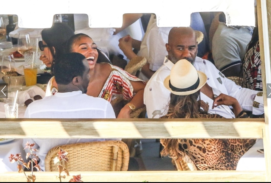 Diddy, 49, and rumored girlfriend Lori Harvey, 22, pack on the PDA during outing with her family. (Photos)