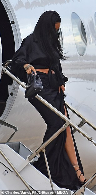 Rihanna flaunts her hot legs in sexy thigh-high split skirt as she touches down in Barbados (Photos)
