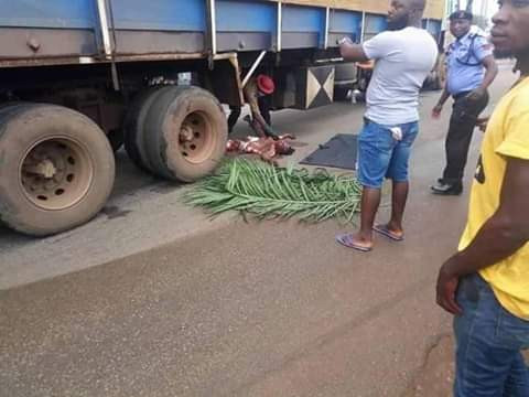 Graphic: Trailer crushes commercial motorcyclist and female passenger to death in Benue
