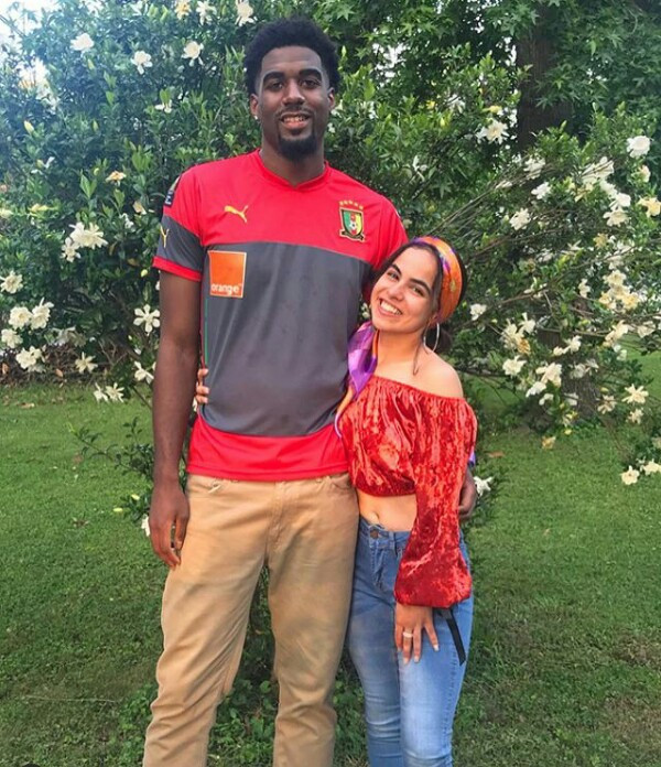 Photos: See how low this tall man has to go to kiss his petite wife