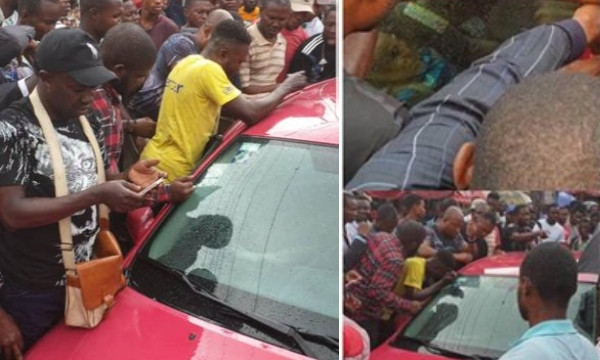 Baby gasping for air after being locked up in a car by his mum, rescued by traders in Lagos (video)