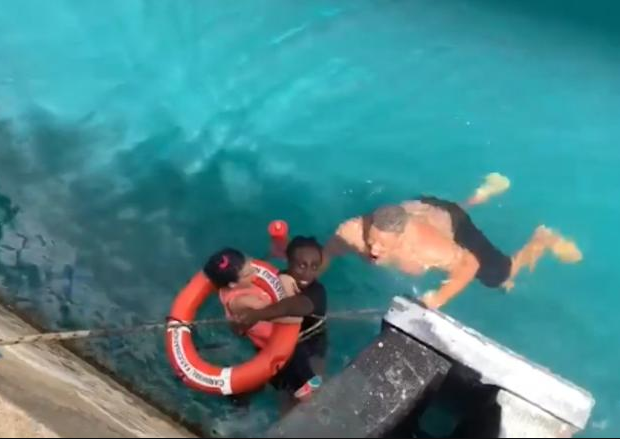 "Moment two ""heroes"" jumped into the ocean to save a girl after her wheelchair rolled off dock and threw her into the water"