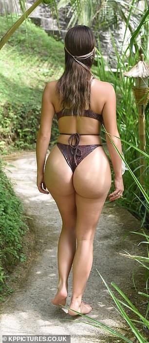 Demi Rose flaunts her incredible curves in skimpy snakeskin bikini as she poses in Bali jungle (Photos)