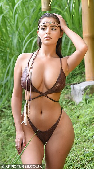 Demi Rose flaunts her incredible curves in skimpy snakeskin bikini as she poses in Bali jungle (Photos)