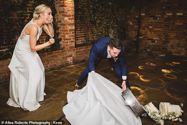 Newlyweds looked on in horror as their wedding cake collapsed during cutting ceremony (Photos)