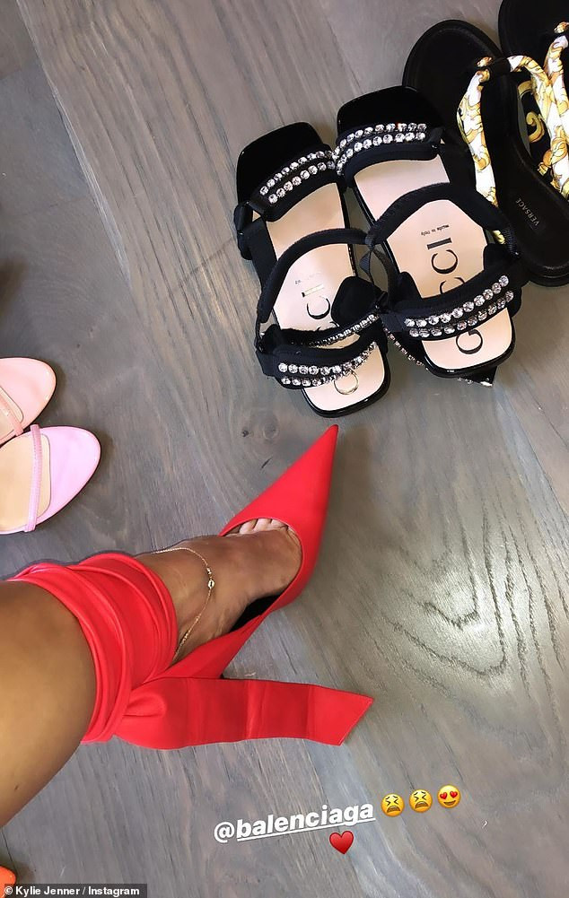 Kylie Jenner shows off her lavish shoe closet after going on shopping sprees at Gucci and Balenciaga (Photos)