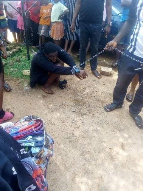 Photos: Woman chained and paraded for allegedly stealing from an orphanage in Anambra