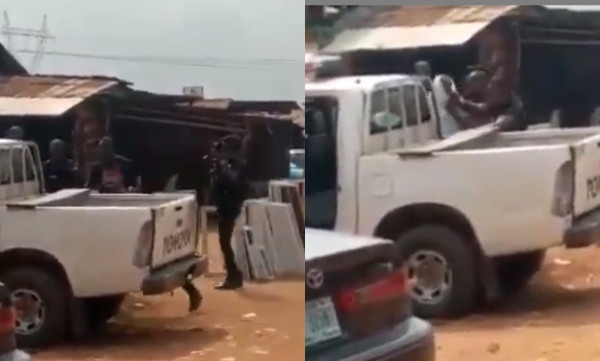 SARS officers stopped from moving their van by angry Benin residents after assaulting young man during arrest (video)