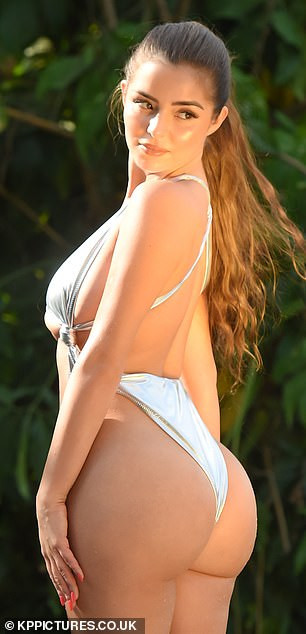 Demi Rose flaunts serious underboob and curves in racy metallic cut-out Playboy swimsuit (Photos)