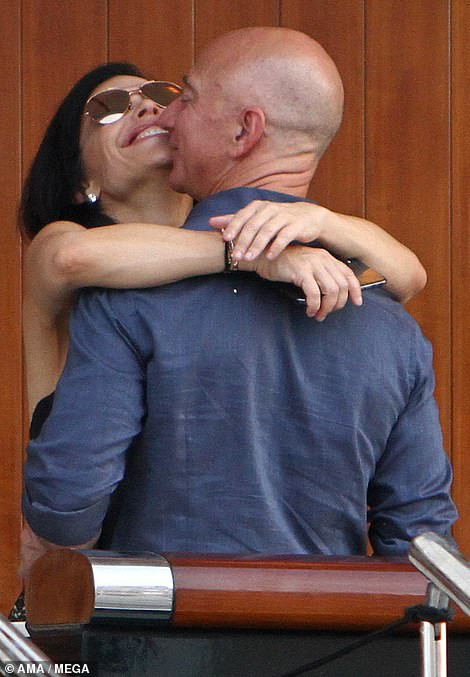 Jeff Bezos, 55, and Lauren Sanchez, 49, put on public display of affection as they kiss & cuddle during a trip to Venice (Photos)