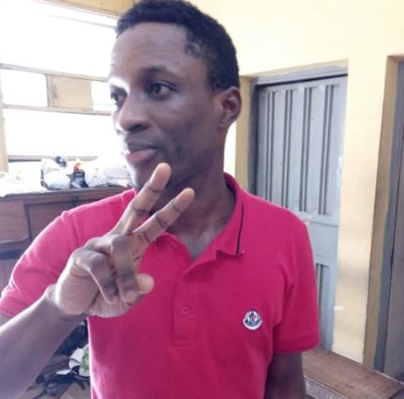 Suspected Yahoo boy pose for picture shortly after his arrest in Lagos(photo)