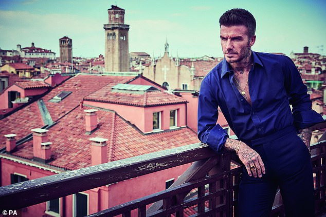 David Beckham channels his inner?James Bond?in striking GQ cover shoot as he wins Editor