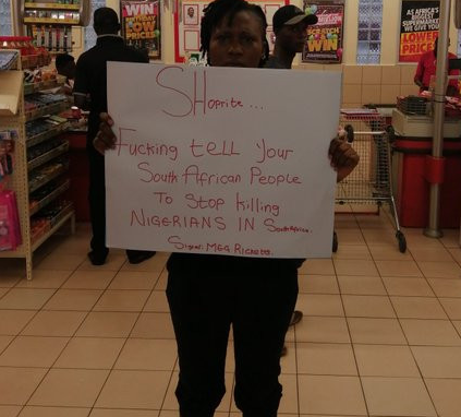 #Xenophobia: Nigerian lady stages peaceful protest at Shoprite Surulere (video)