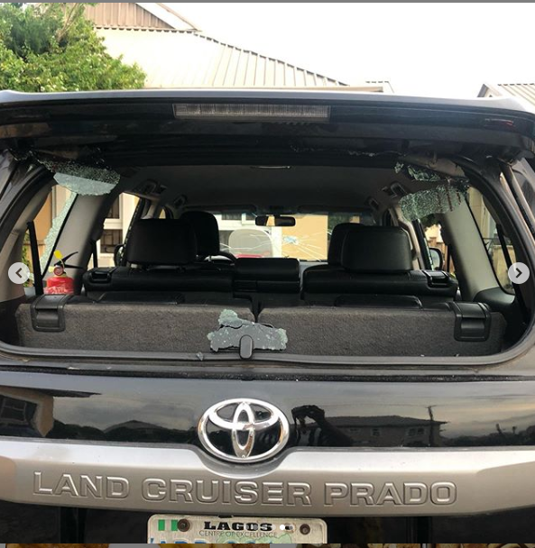 Xenophobia: Lady shares photos of injuries she sustained and damages done to her car after being attacked in Lagos protest