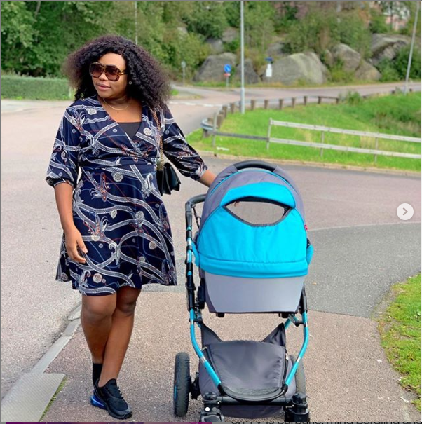 Actress Ruth Kadiri steps out with her baby daughter Reign as they enjoy a stroll (Photos)
