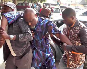 Senator Dino Melaye unable to 'stand' at the resumed hearing of his criminal trial in Abuja