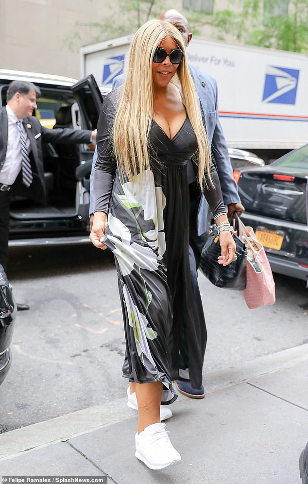 Wendy Williams flaunts her ample cleavage as she steps out for appearance on Late Night With Seth Meyers (Photos)