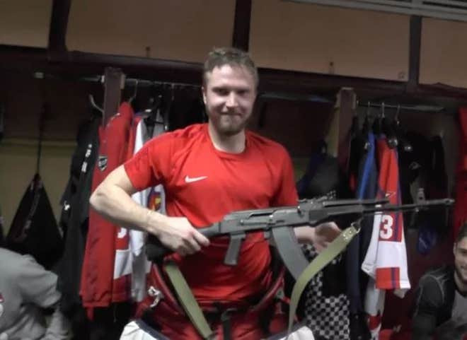 Russian goalkeeper given an AK-47 rifle as man of the match prize (see photos)