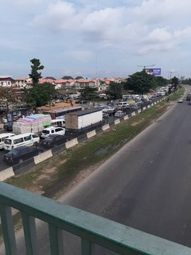 Tanker filled with diesel falls on Otedola bridge, spills content across the road (photos/video)