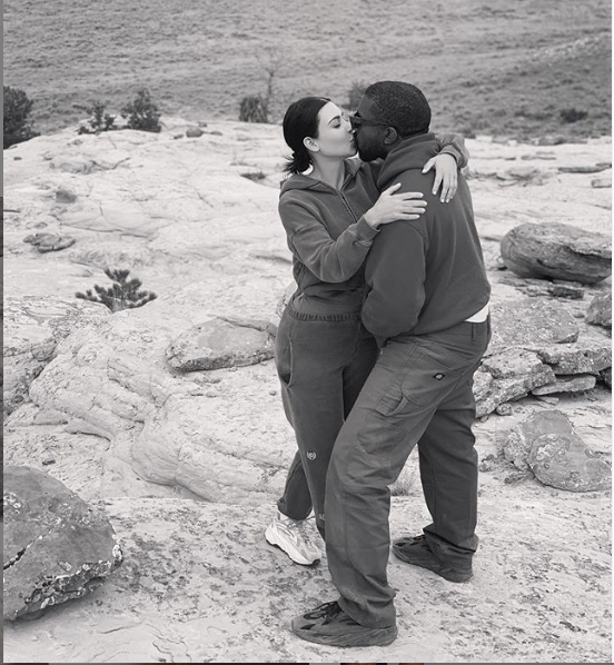 Kim Kardashian shares a sweet kiss with her husband Kanye West in new loved-up photo