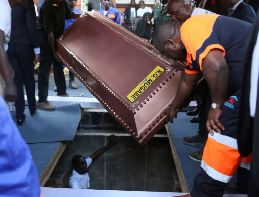 Robert Mugabe buried in?steel coffin encased in concrete as family claims people are