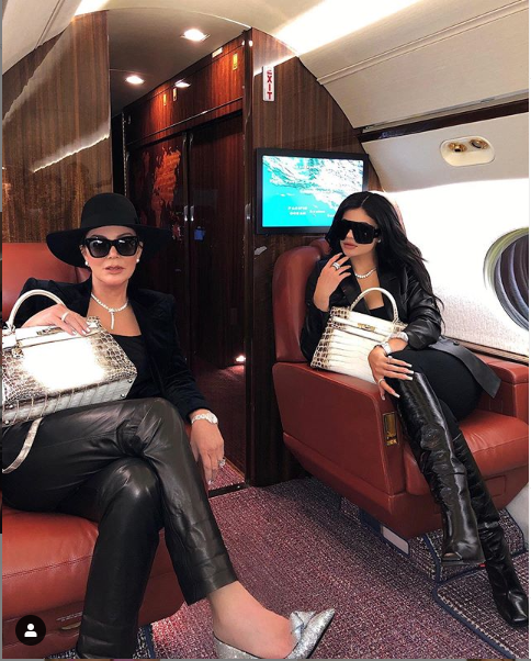 Kylie Jenner and her mom Kris travel in style as they board a private jet to a
