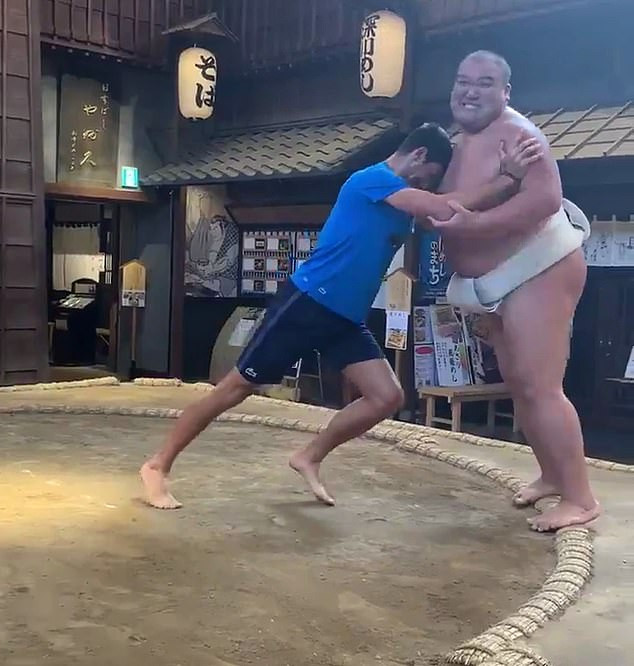 Watch Tennis star Novak Djokovic hilariously battle sumo wrestlers in Japan (video)