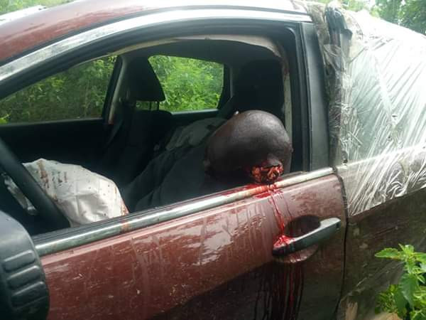 Unidentified man found dead in a car with gunshot wound to his head on Abuja-Lokoja road (graphic photos)