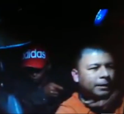Brave moment cab driver fought back when a man held a gun to his head in his taxi (video)