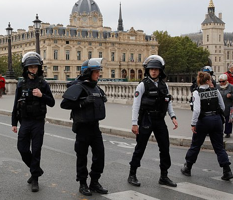 Knife wielding?man shot dead after?killing?a policewoman and injuring five other officers during an attack?inside Paris police headquarters