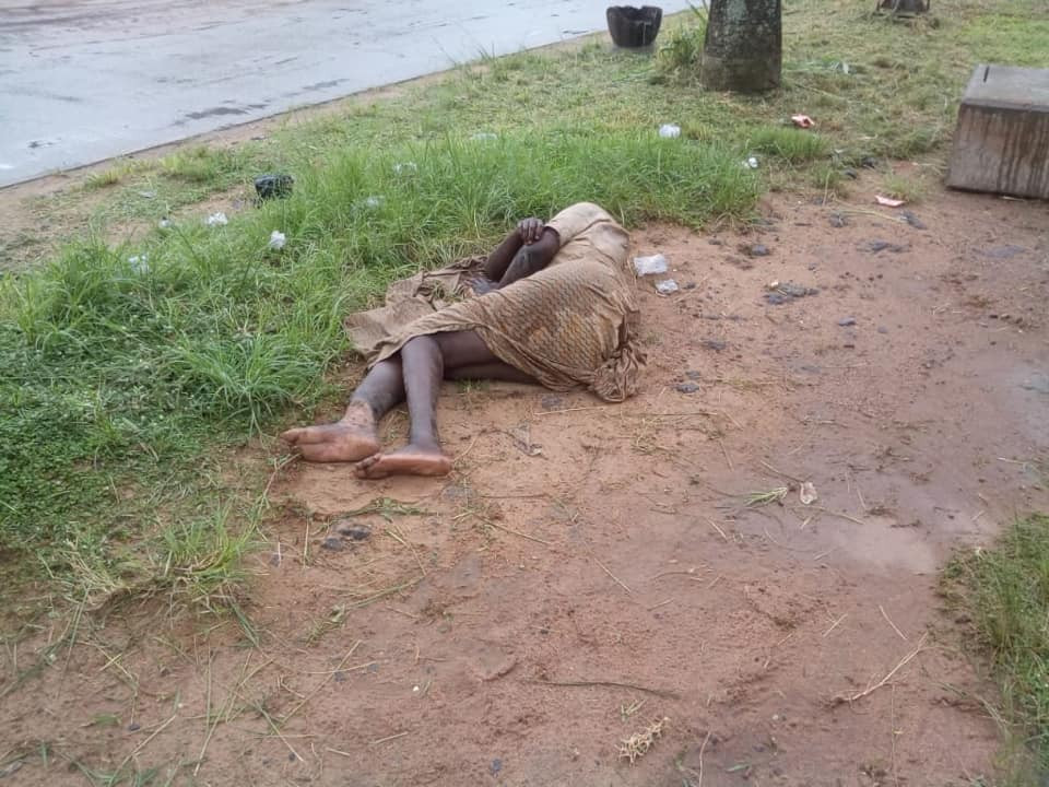 Woman spotted lying in same spot for over a week in Lagos (photos)