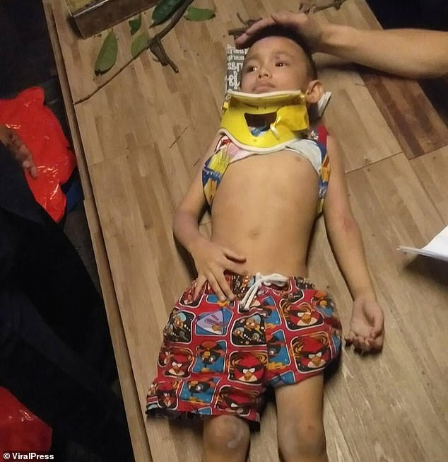 Four-year-old boy plunges 100ft off a balcony in Thailand but miraculously survives with no bones broken (Photos/Video)