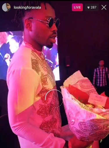 #BBNaijaFinale: Ike spotted with a bouquet of flowers for his boo, Mercy?(Photos)