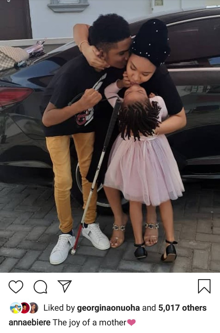 Anna Ebiere receives a kiss from Flavour