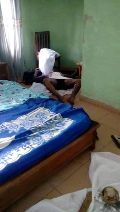 Man dressed like a herbalist allegedly found dead in hotel room in Ebonyi, calabash containing money spotted on a white cloth (grahic photos)