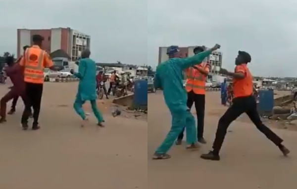 Men spotted fighting a traffic warden (video)
