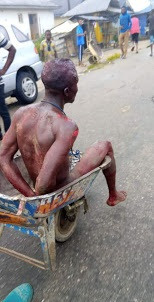 Suspected thief stripped naked, beaten to bloody pulp and paraded in wheelbarrow in Elebele, Bayelsa
