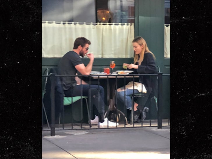 Liam Hemsworth spotted holding hands with a mystery woman after split from Miley Cyrus