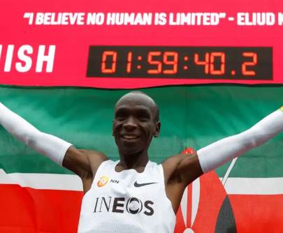 Image result for images of Kenya's Eliud Kipchoge becomes the first athlete to run a marathon in less than two hours