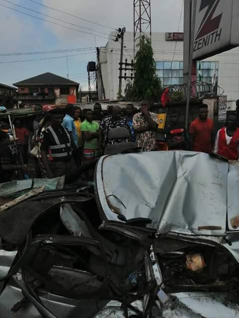 Photos: Two injured as container falls in Onitsha