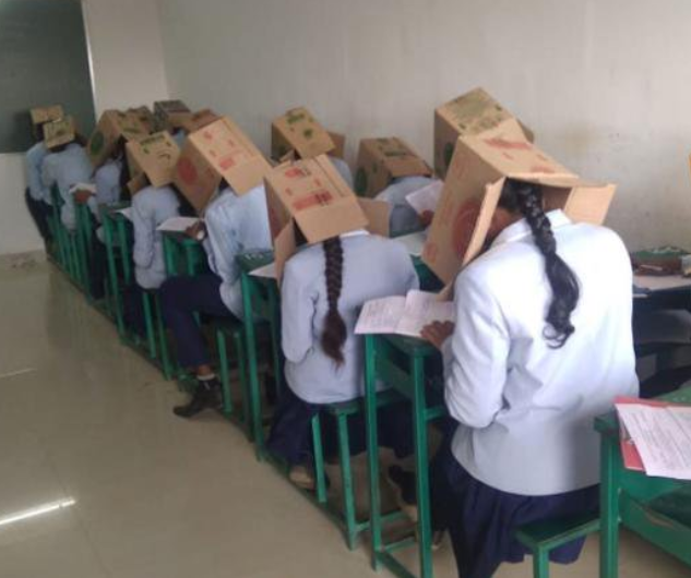 Exam malpractice: School apologises after photos of students wearing cardboard boxes on their heads during an exam goes viral