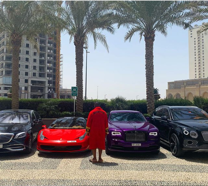 'I Never Fold... Never!' - Hushpuppi says as he poses in front of his luxury vehicles